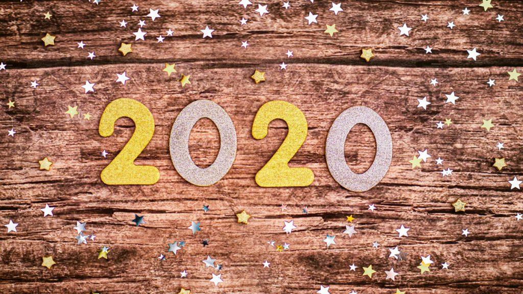 Image of the word 2020 on a wooden board surrounded by stars. Image by Jamie Street.